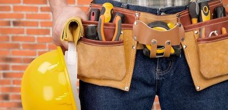 tool belt and hardhat worn by a home contractor in Upstate NY