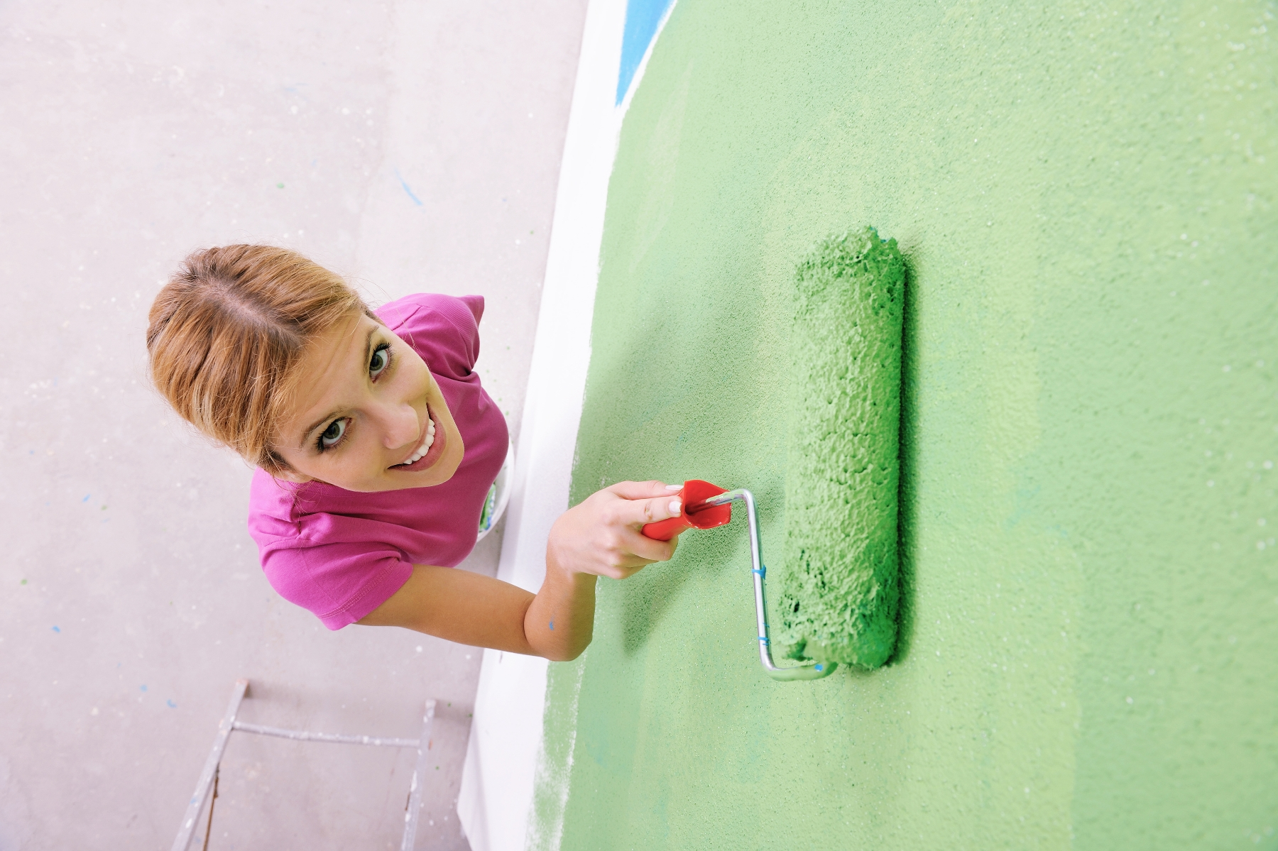 Woman painting an accent wall