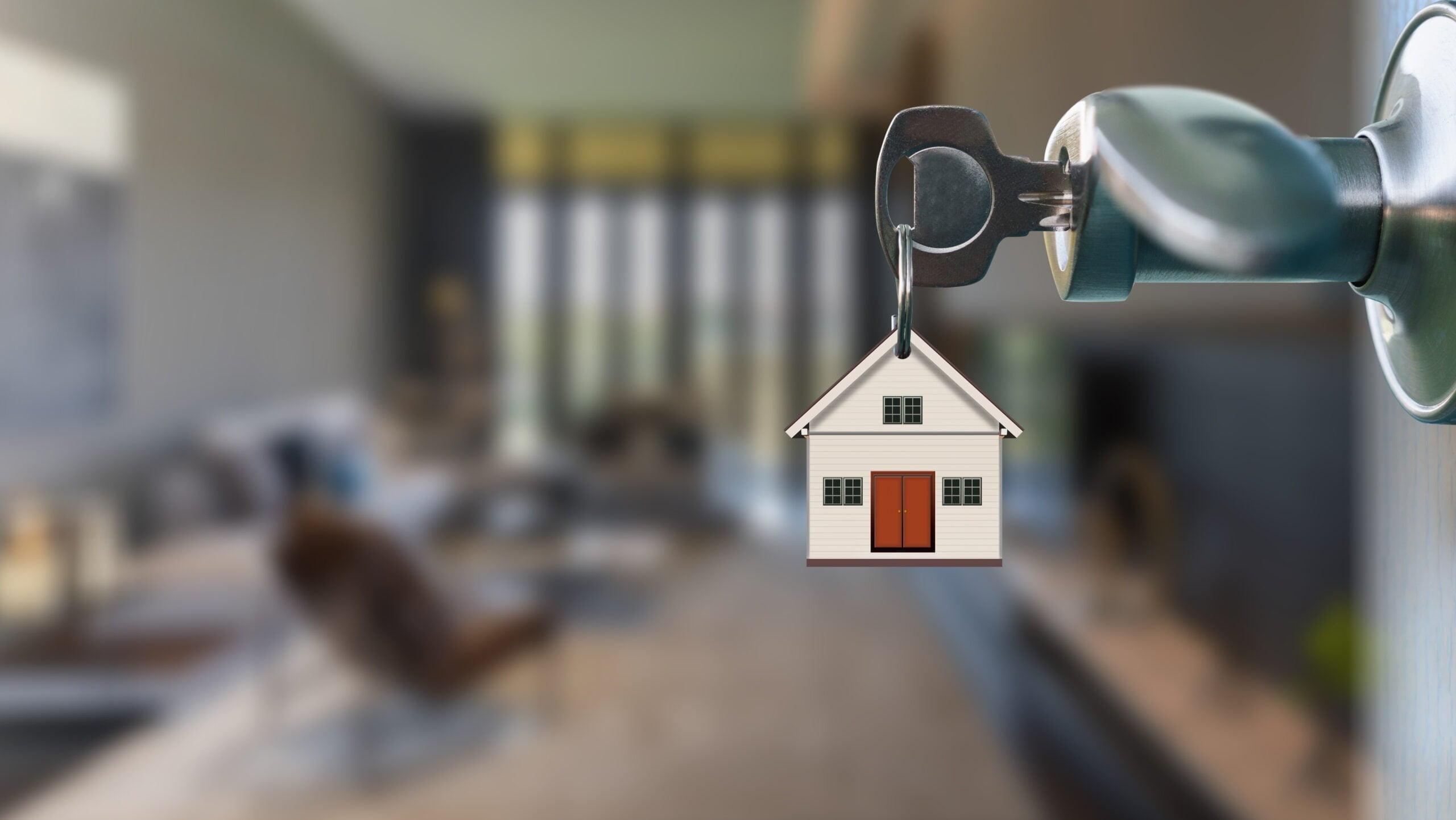 key in open door leading to an open floorplan