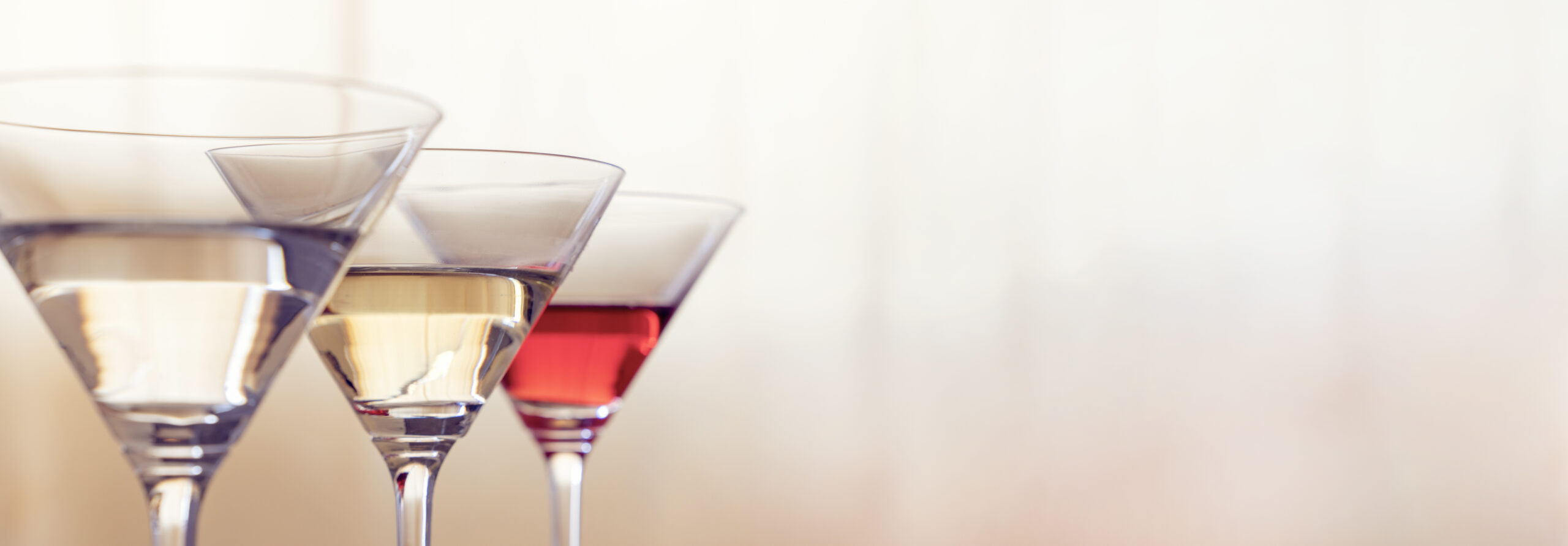 Three martini glasses with recipes made at home