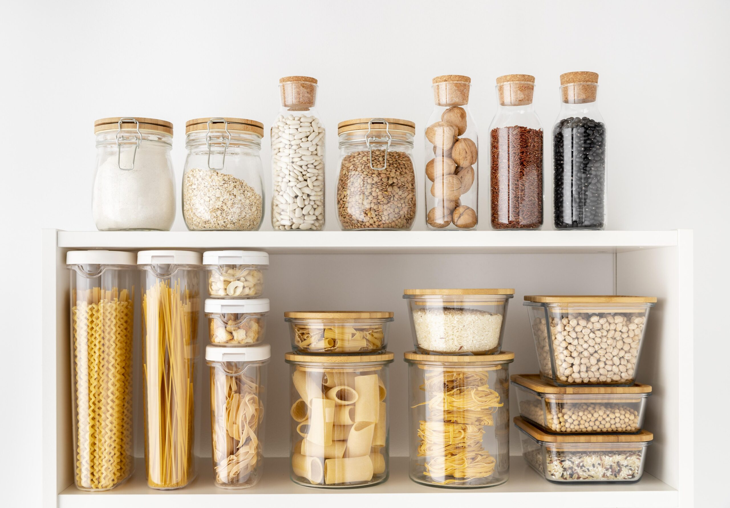 pairing up similar storage containers in organized layout on shelf in kitchen pantry