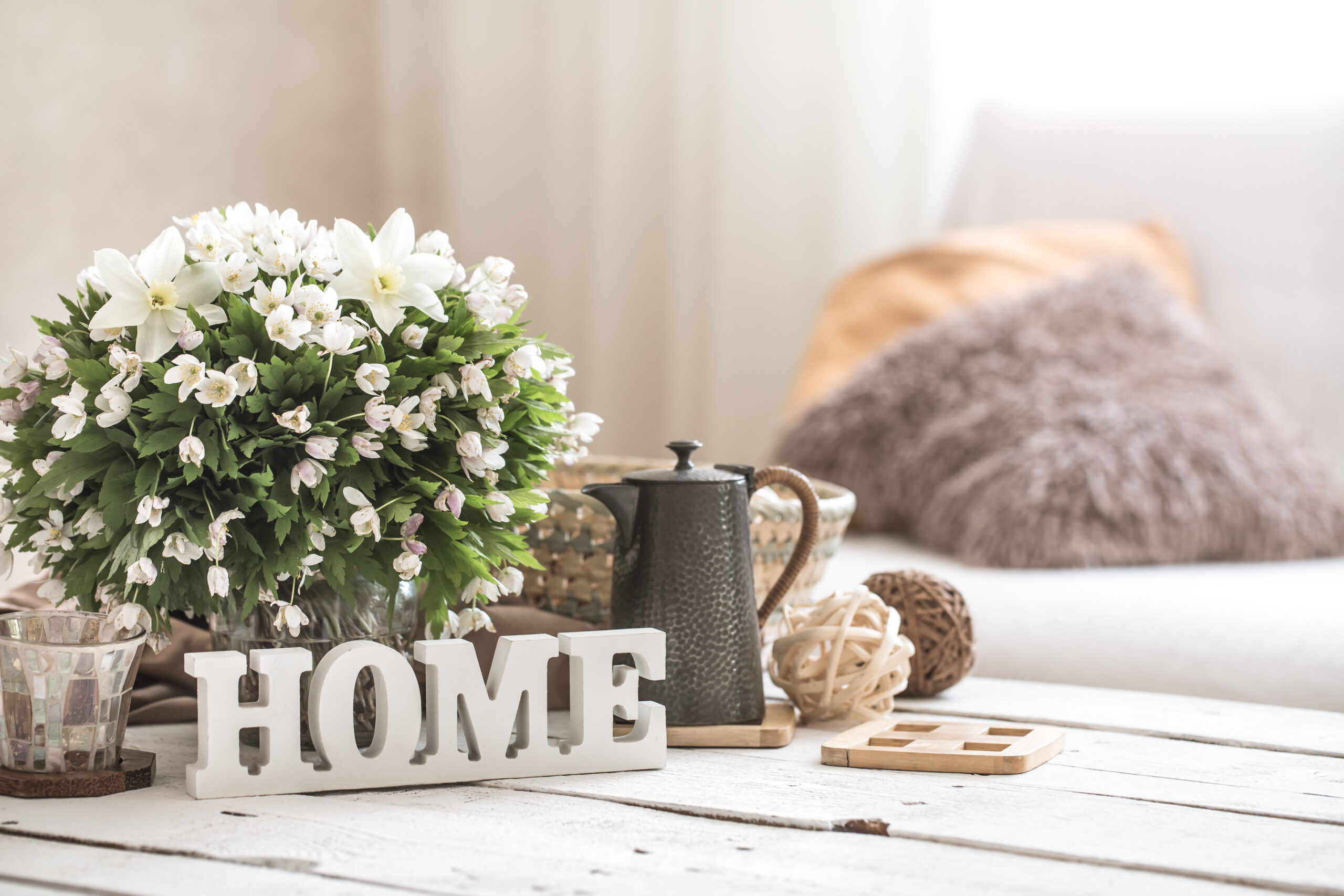 coffee table with accent decor to create modern farmhouse aesthetic
