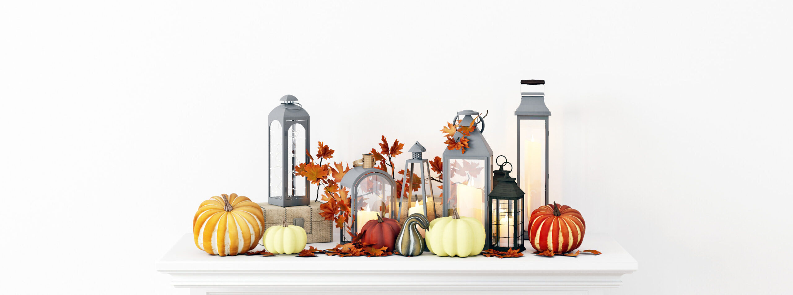 fall mantel decor with pumpkins leaves and lanterns in room in home