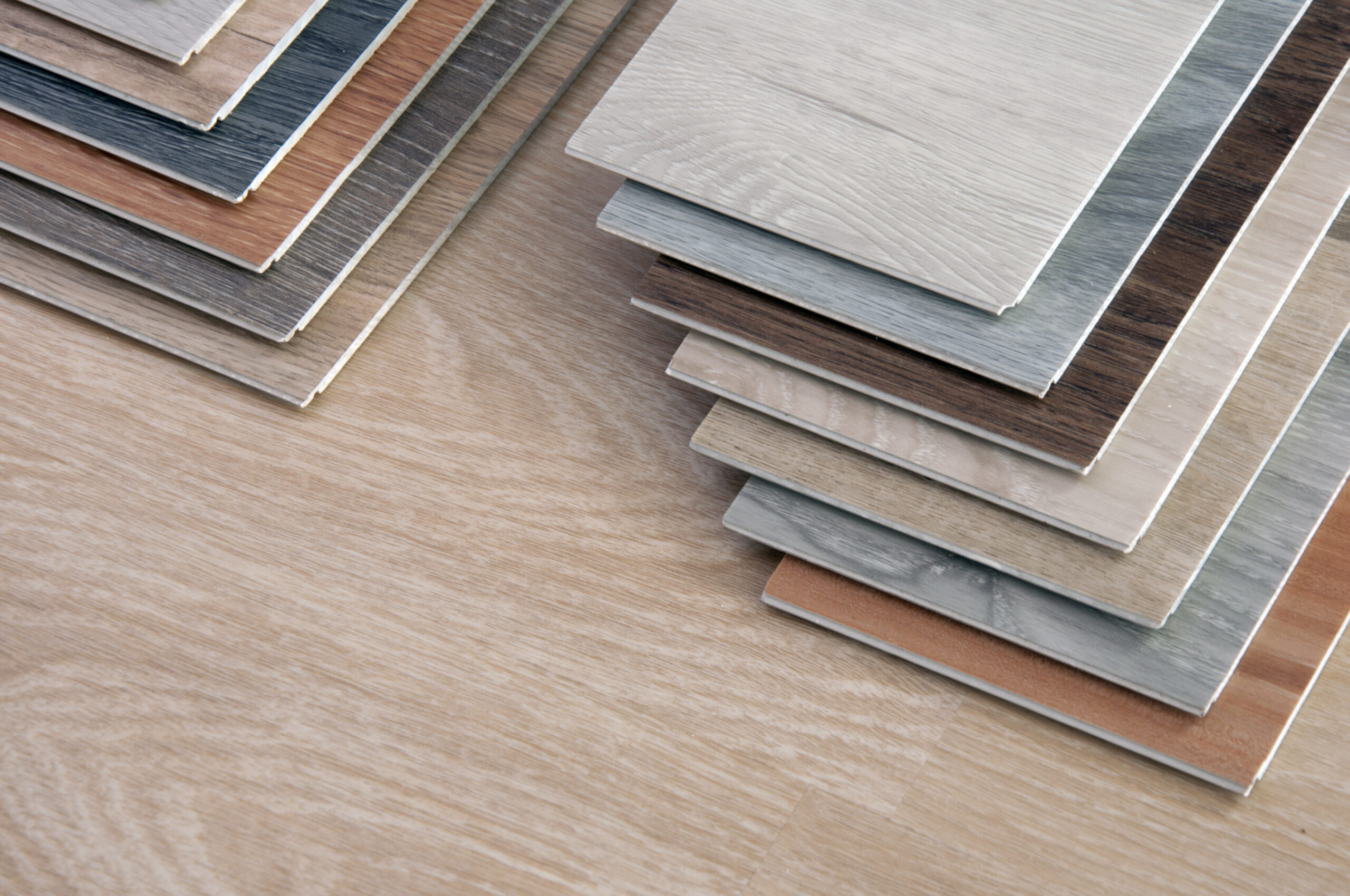 laminate plank samples laid out on floor