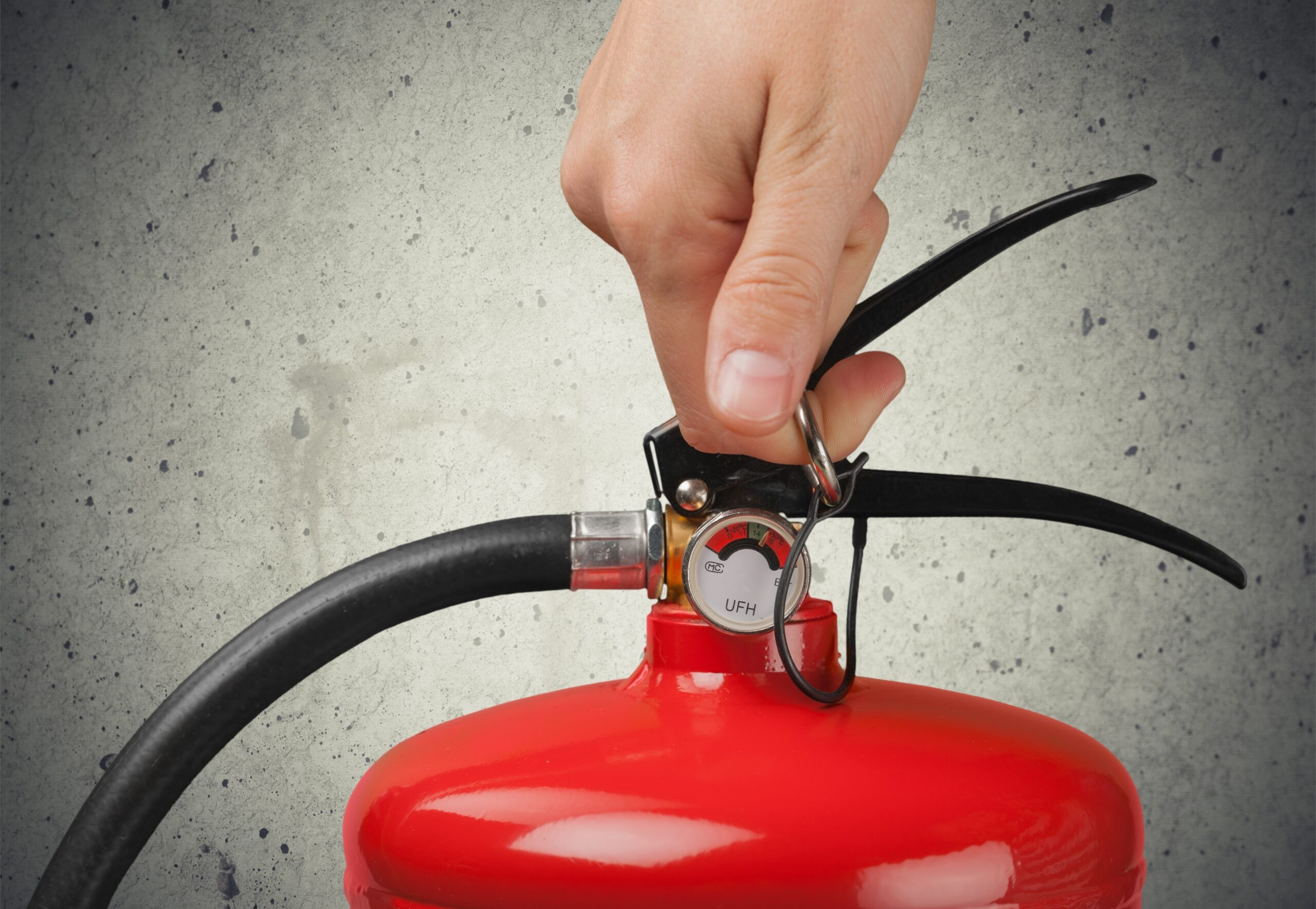 person holding fire extinguisher for home fire safety