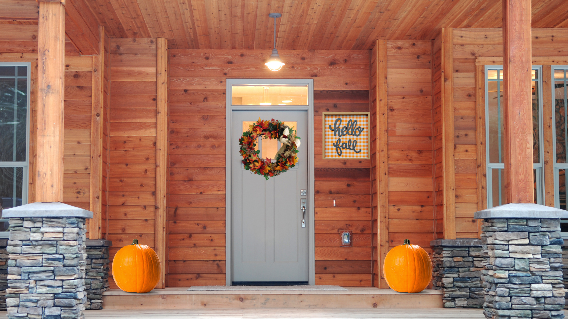 trendy fall sign on outside of house on fall front porch